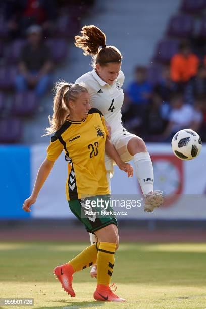 Emilie Bernhardt from Germany U17 Girls fights for the ball with Loreta Rogaciova from Lithuania U17 Girls during soccer match Lithuania U17 Girls v...