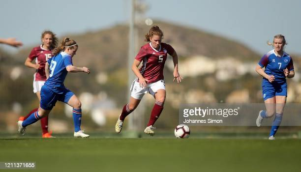 Emilie Bernhardt of Germany and Karen Maria Sigurgeirsdottir of Iceland fight for the ball during the U19 Women's Tournament match between Germany...