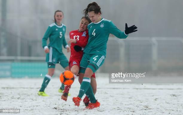 Emilie Bernhardt of Germany battles for the ball with Anna Abulashvili of Azerbaijan during the UEFA U17 Girl's European Championship Qualifier match...