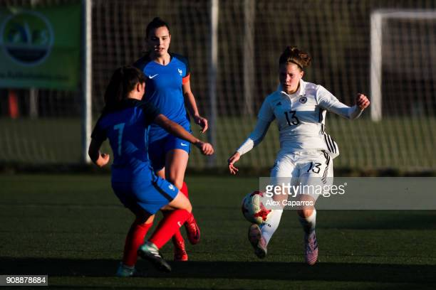 Emilie Bernhardt of Germany controls the ball next to Manon Revelli of France during the U17 girl's international friendly match between Germany and...