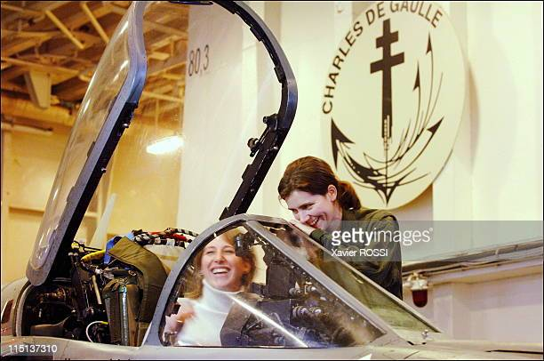 Emilie Denis the first woman fighter pilot of the French Navy in Toulon France on January 18 2006 With Maud Fontenoy sitting in Emilie Denis' Super...