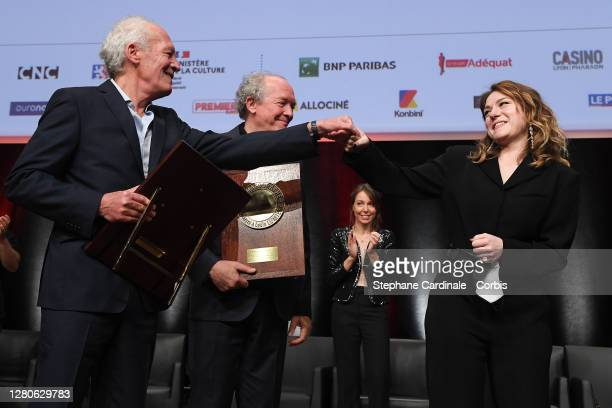 """Emilie Dequenne greets Luc Dardenne and Jean-Pierre Dardenne after giving them their """"Prix Lumiere"""" during the tribute to the brothers Jean-Pierre..."""
