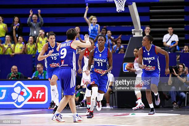 Emilie Gomis and Celine Dumerc of the French Basketball Women's National Team celebrate a basket during the game between France and USA at Stade...