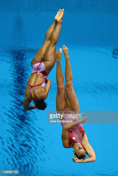 Emilie Heymans and Jennifer Abel of Canada dive during the Women's Synchronized 3m Springboard Final at the London 2012 Olympic Games on July 29 2012...