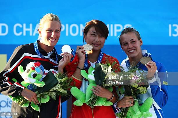 Emilie Heymans of Canada celebrates the silver medal Jingjing Guo of China the gold medal and Tania Cagnotto of Italy the bronze medal during the...