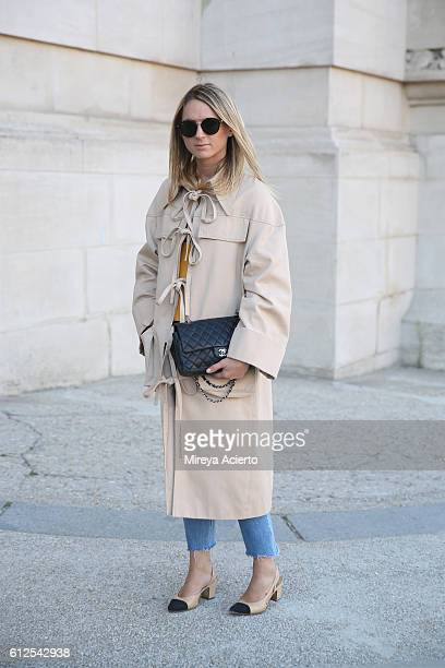 Emilie Higle seen wearing Marianna Sencha coat and Chanel bag and shoes during Paris Fashion Week Spring/Summer 2017 on October 4 2016 in Paris France