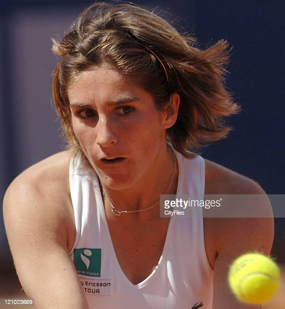 Emilie Loit in action against Natalia Gussoni during their second round match in the 2006 Estoril Open at the Estadio Nacional in Estoril Portugal on...