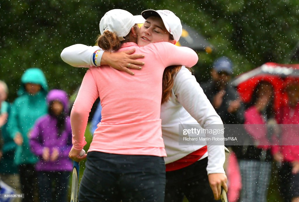 Emilie Overas of Norway congratulates Lily May Humphreys of England (R) on her victory on the 13th green during the final of the Girls' British Open Amateur Championship at Enville Golf Club on August 19, 2017 in Stourbridge, England.