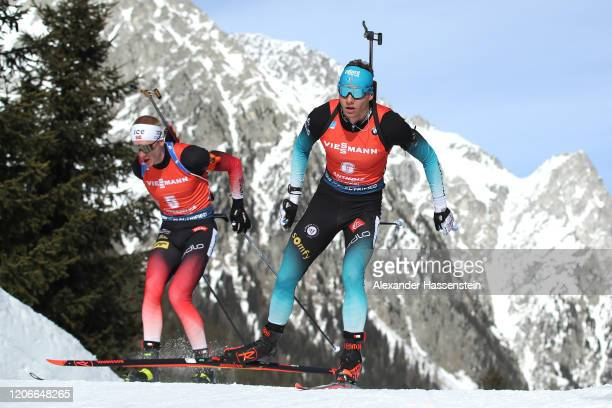 Emilien Jacquelin of France competes ahead of Johannes Thingnes Boe of Norway during the Men 12.5 km Pursuit Competition at the IBU World...
