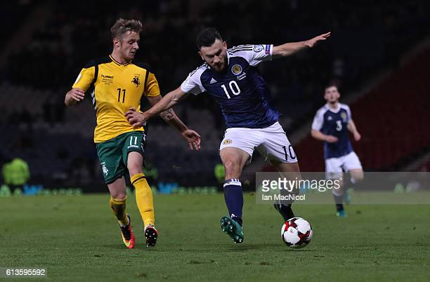 Emilijus Zubas of Lithuania vies with Robert Snodgrass of Scotland during the FIFA 2018 World Cup Qualifier between Scotland and Lithuania at Hampden...