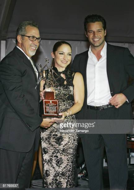 Emilio and Gloria Estefan with Ricky Martin pose at the City of Hope Spirit of Life Gala on November 18 2004 in South Beach Florida