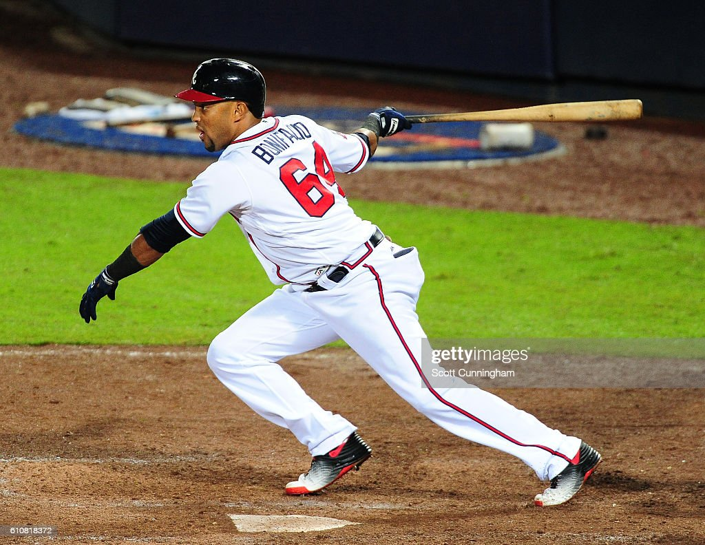 Emilio Bonafacio #64 of the Atlanta Braves knocks in the eventual game winning run with an eighth inning single against the Philadelphia Phillies at Turner Field on September 27, 2016 in Atlanta, Georgia.