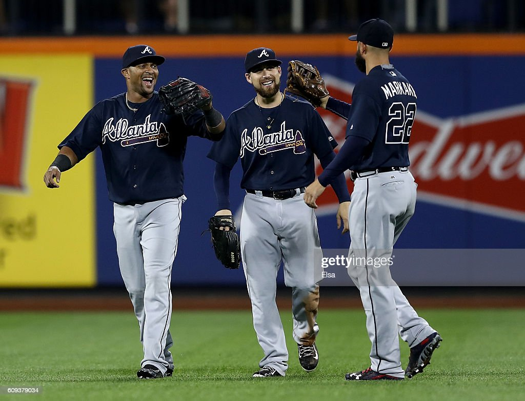 Emilio Bonifacio #64, Ender Inciarte #11 and Nick Markakis #22 of the Atlanta Braves celebrate the 5-4 win over the New York Mets on September 20, 2016 at Citi Field in the Flushing neighborhood of the Queens borough of New York City.