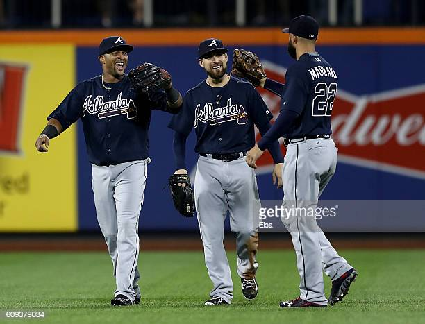 Emilio Bonifacio, Ender Inciarte and Nick Markakis of the Atlanta Braves celebrate the 5-4 win over the New York Mets on September 20, 2016 at Citi...