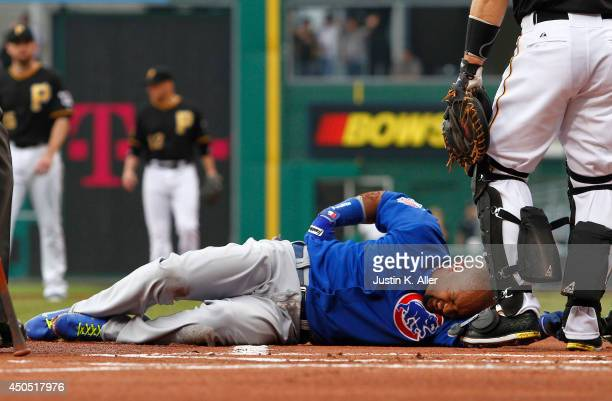 Emilio Bonifacio of the Chicago Cubs grimmaces with an injury in the first inning during the game against the Pittsburgh Pirates at PNC Park on June...