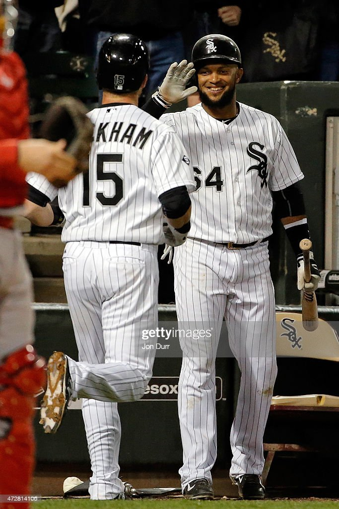Emilio Bonifacio #64 of the Chicago White Sox congratulates Gordon Beckham #15 after he hit a one run home run during the sixth inning against the Cincinnati Reds in the second game of a doubleheader on May 9, 2015 at U.S. Cellular Field in Chicago, Illinois. The Chicago White Sox won 8-2.