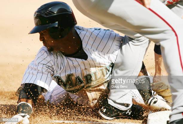 Emilio Bonifacio of the Florida Marlins steals third base in the third inning against the Washington Nationals on opening day at Dolphin Stadium on...