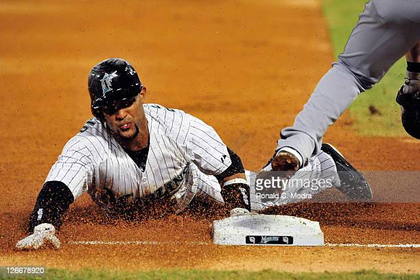 Emilio Bonifacio of the Florida Marllns slides into third base during a MLB game against the Atlanta Braves at Sun Life Stadium on September 21 2011...