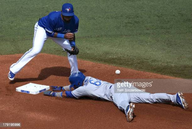 Emilio Bonifacio of the Kansas City Royals steals second base in the first inning during MLB game action as Jose Reyes of the Toronto Blue Jays...