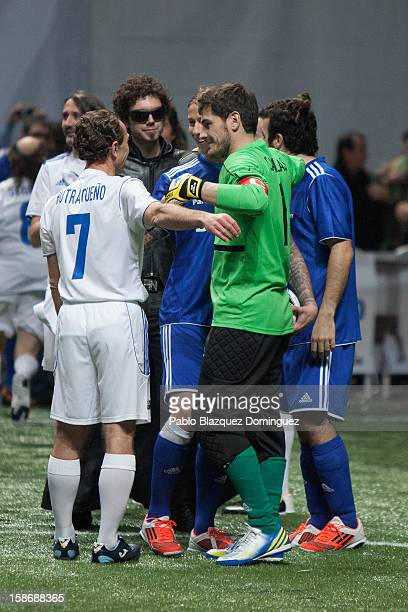 Emilio Butragueno Guti and Iker Casillas embrace each other during 'Partido X La Ilusion' by Iker Casillas Foundation at Palacio de los Deportes on...