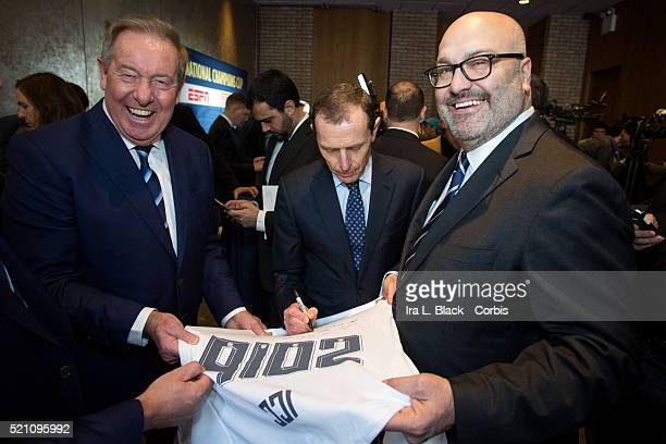 Emilio Butragueno of Real Madrid signs the 2016 ICC Real Madrid shirt with Charlie Stillitano Chairman of Relevent Sports and Alan Birchenall of...