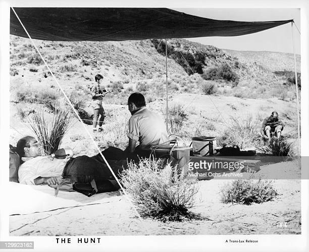 Emilio Caba Alfredo Mayo and Jose Prada resting from their hunt in a scene from the film 'The Hunt' 1967