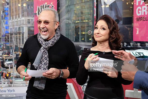 "Emilio Estefan and Gloria Estefan visit ""Extra"" at their New York Studios at H&M in Times Square on November 18, 2015 in New York City."