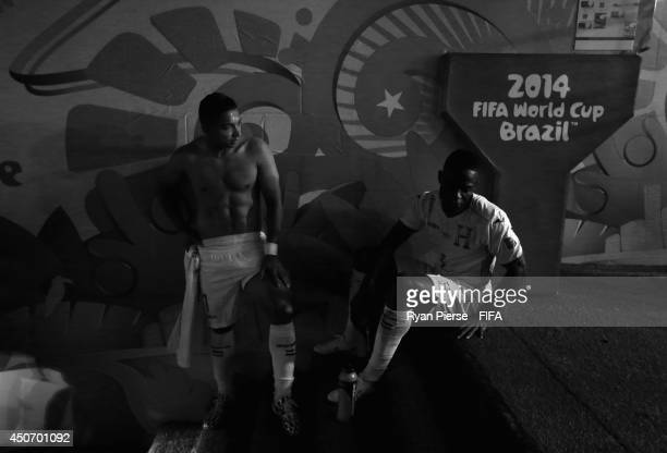 Emilio Izaguirre and Maynor Figueroa of Honduras look dejected after the 2014 FIFA World Cup Brazil Group E match between France and Honduras at...