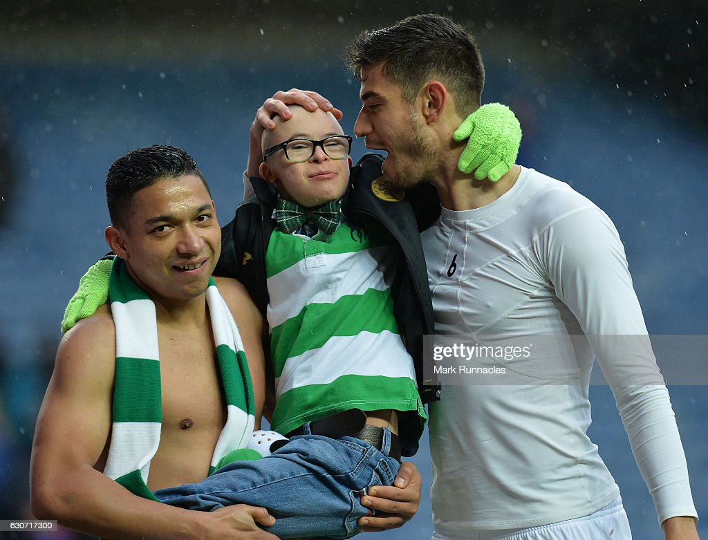 Emilio Izaguirre (L), and Nir Bitton of Celtic celebrate at the final Whistle with a young fan during the Scottish Premiership match between Rangers FC and Celtic FC at Ibrox Stadium on December 31, 2016 in Glasgow, Scotland.