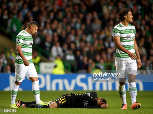 Emilio Izaguirre and Virgil van Dijk of Celtic look on as Neymar of Barcelona is injured during the UEFA Champions League Group H match between...