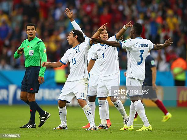 Emilio Izaguirre , Emilio Izaguirre and Maynor Figueroa of Honduras protest France's second goal with referee Sandro Ricci during the 2014 FIFA World...