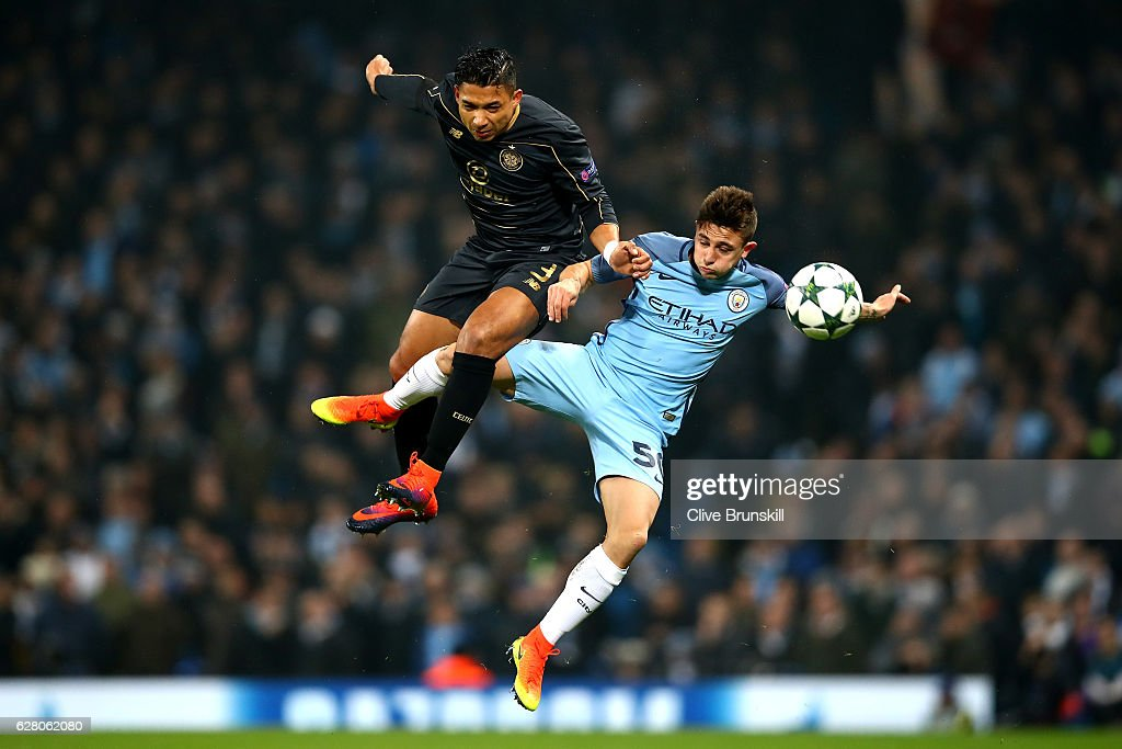 Emilio Izaguirre of Celtic (L) and Pablo Maffeo Becerra of Manchester City (R) both battle to win a header during the UEFA Champions League Group C match between Manchester City FC and Celtic FC at Etihad Stadium on December 6, 2016 in Manchester, England.