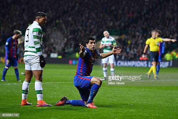 Emilio Izaguirre of Celtic fouls Luis Suarez of Barcelona for a Barcelona penalty during the UEFA Champions League Group C match between Celtic FC...