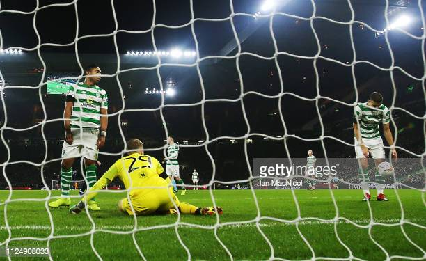 Emilio Izaguirre of Celtic looks on after Celtic concede their second goal during the UEFA Europa League Round of 32 First Leg match between Celtic...