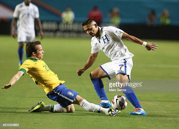 Emilio Izaguirre of Honduras plays against Bernard of Brazil during a friendly between Brazil and Honduras at Sun Life Stadium on November 16, 2013...