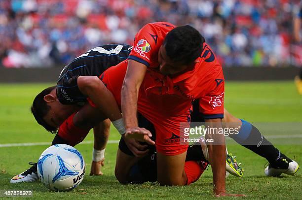 Emilio Lopez of Queretaro struggles for the ball with Ignacio Gonzalez of Morelia during a 8th round match between Queretaro and Morelia as part of...