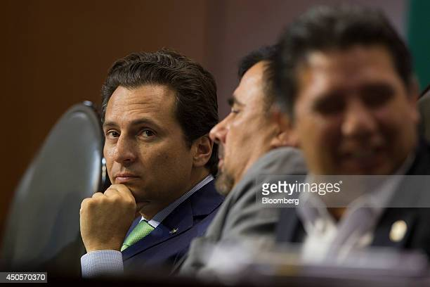 Emilio Lozoya chief executive officer of Petroleos Mexicanos left listens during a session of the lower house of the Mexican Congress in Mexico City...