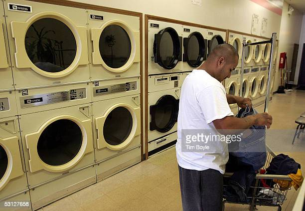 Emilio Marquez folds clothes near a bank of Maytag commercial dryers in a laundromat June 22 2005 in Niles Illinois Chinese appliance maker Haier has...