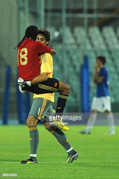 Emilio Nsue Lopez with Tomas Mejias Osorio goalkiper of Spain celebrate victory during Final footballl match between Italy and Spain at the XVI...