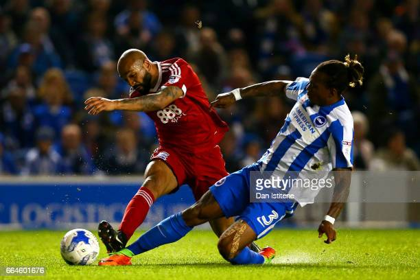 Emilio Nsue of Birmingham City shoots at goal under pressure from Gaetan Bong of Brighton Hove Albion during the Sky Bet Championship match between...