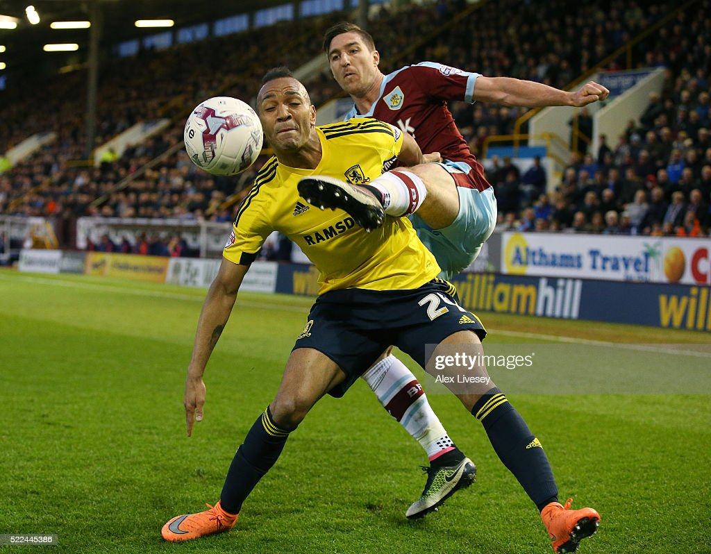 Emilio Nsue of Middlesbrough and Stephen Ward of Burnley battle for the ball during the Sky Bet Championship match between Burnley and Middlesbrough at Turf Moor on April 19, 2016 in Burnley, United Kingdom.