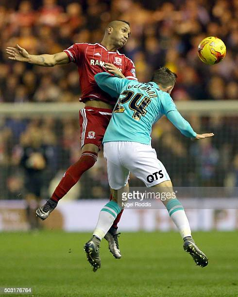 Emilio Nsue of Middlesbrough challenges Andreas Weimann of Derby County during the Sky Bet Championship soccer match between Middlesbrough and Derby...