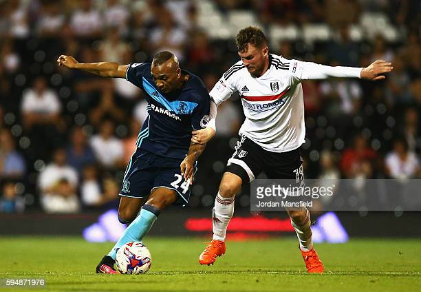 Emilio Nsue of Middlesbrough is challenged by Ryan Tunnicliffe of Fulham during the EFL Cup second round match between Fulham and Middlesbrough at...