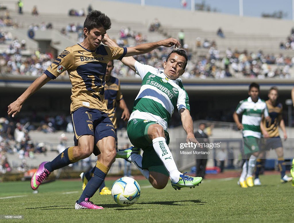 Emilio Orrantia of Pumas fights for the ball with Juan Pablo Rodriguez of Santos during a match between Pumas and Santos as part of the Clausura 2013 at Olímpico Stadium on February 03, 2013 in Mexico City, Mexico.
