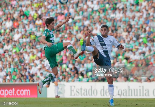 Emilio Orrantia of Santos and Anderson Santamaria of Puebla fight for the ball during the third round match between Santos Laguna and Puebla as part...