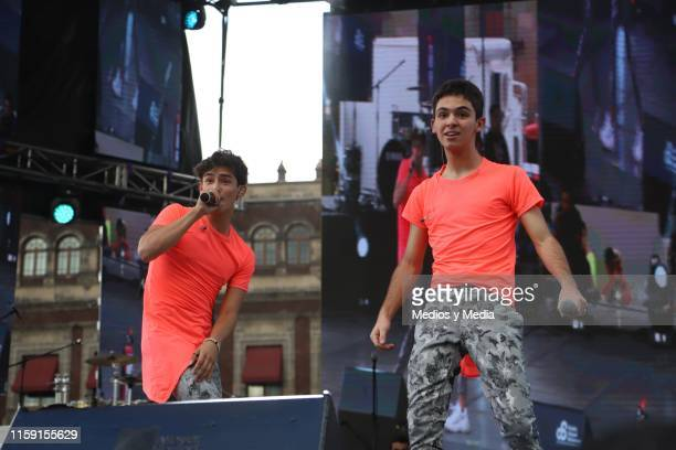 Emilio Osorio and Joaquin Bondoni performs on stage during the 41 LGBTTTI Pride Parade and concert on June 29 2019 in Mexico City Mexico