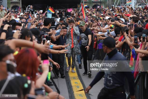 Emilio Osorio performs on stage during the 41 LGBTTTI Pride Parade and concert on June 29 2019 in Mexico City Mexico