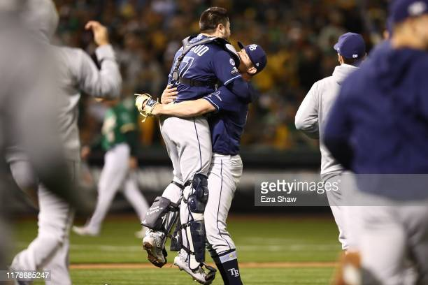 Emilio Pagan of the Tampa Bay Rays celebrates with Travis d'Arnaud after the final out against the Oakland Athletics to win the American League Wild...