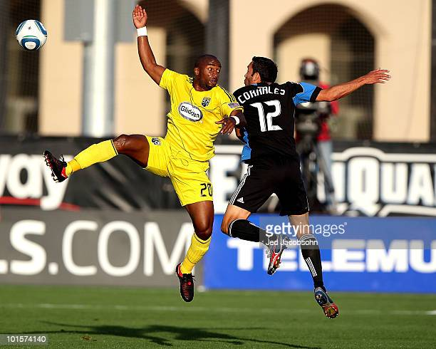 Emilio Renteria of the Columbus Crew battles for the ball with Ramiro Corrales of the San Jose Earthquakes during an MLS game at Buck Shaw Stadium on...