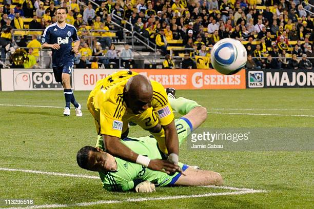 Emilio Renteria of the Columbus Crew collides with goalkeeper Jay Nolly of the Vancouver Whitecaps FC in the second half on April 30 2011 at Crew...